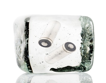Two batteries frozen inside a block of ice