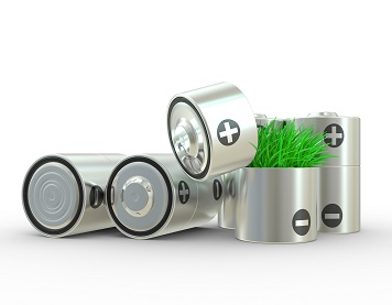 The concept ecologically a net energy. A battery and a grass on a white background